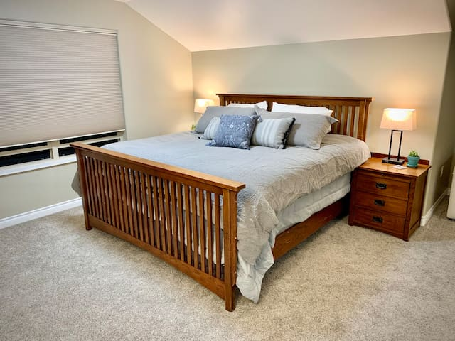 Comfortable King sized bed with Tuft & Needle mint mattress, a soft mattress topper, and luxurious linens.
