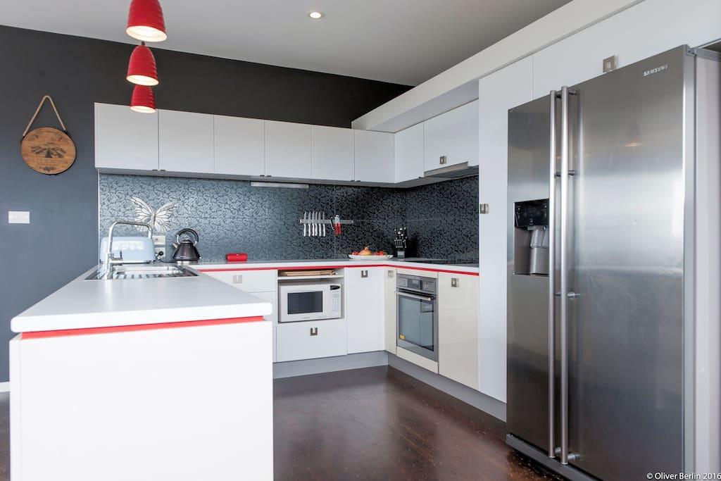 Designer kitchen with AEG oven, induction stove, dishwasher, icemaker fridge...
