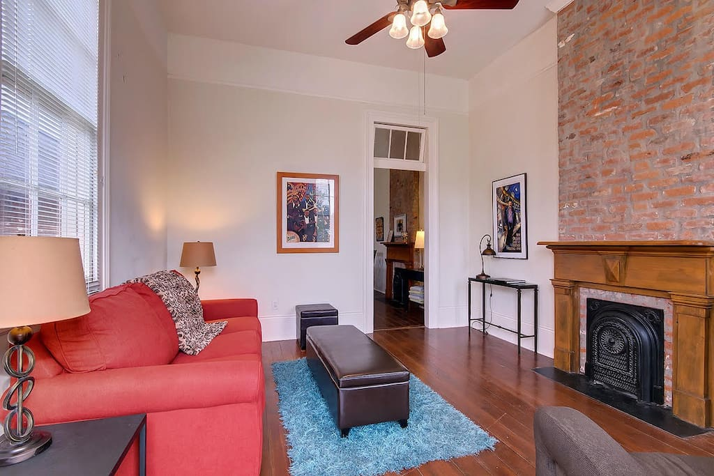 Living room has classic architectural details.