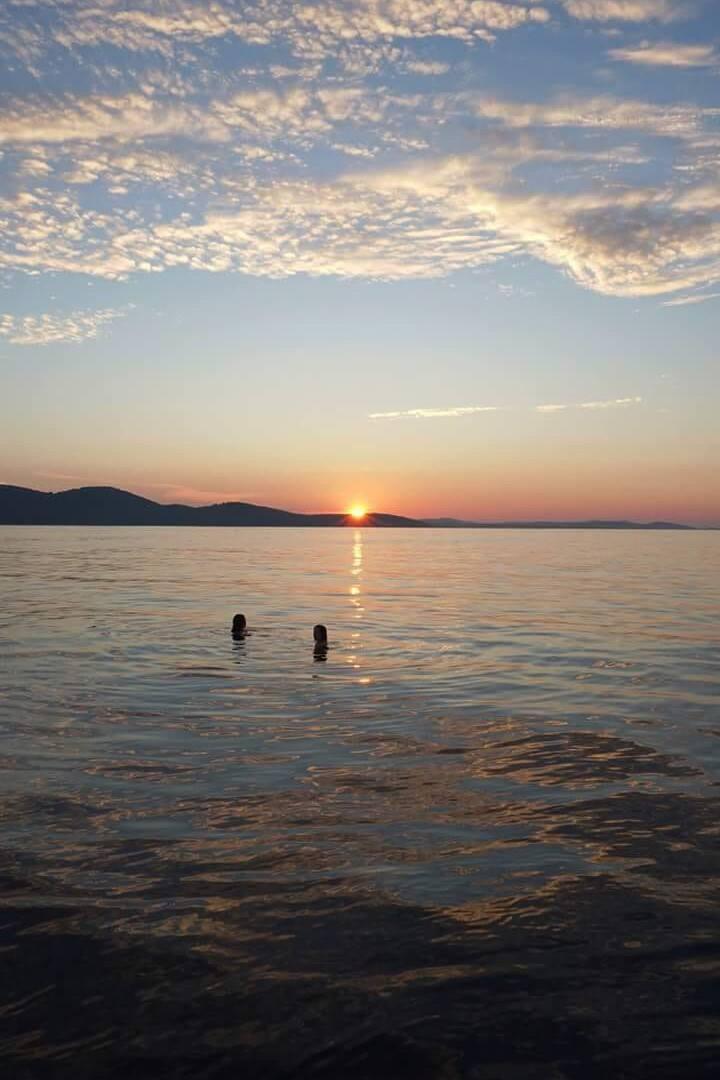 Swim on open sea under the sunset