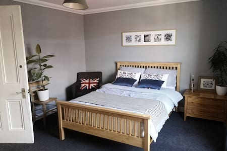Comfortable double bedroom in family home.