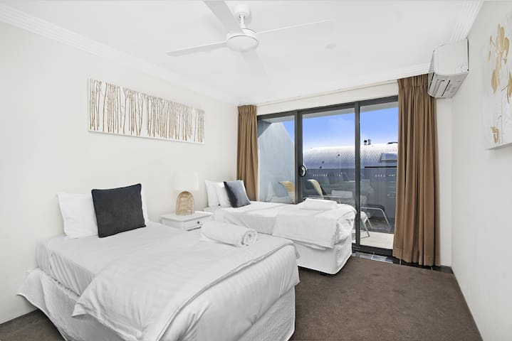 Bedrooms open to lovely terrace & include ceiling fans, aircon & built-in robes