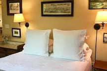 Queen size bed with all cotton bedding.