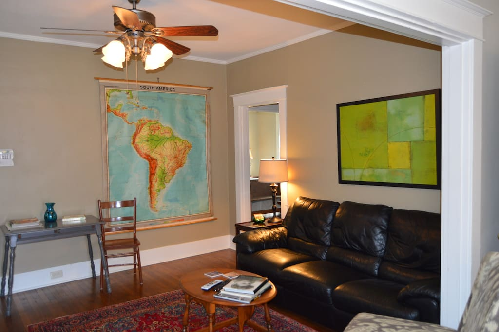 Another living room shot featuring a vintage school map of South America, and a 1920's breakfast table re-purposed as a lap top desk