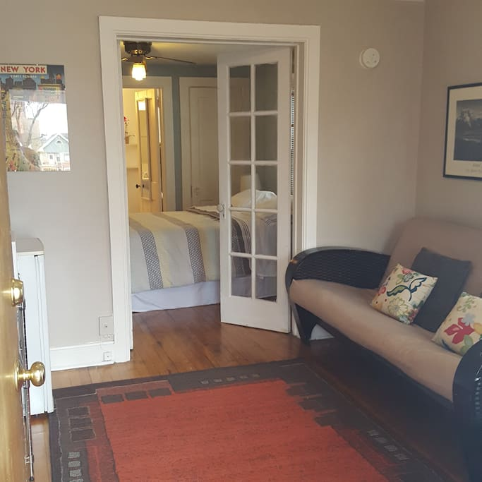 Beautiful french doors separate living from sleeping space