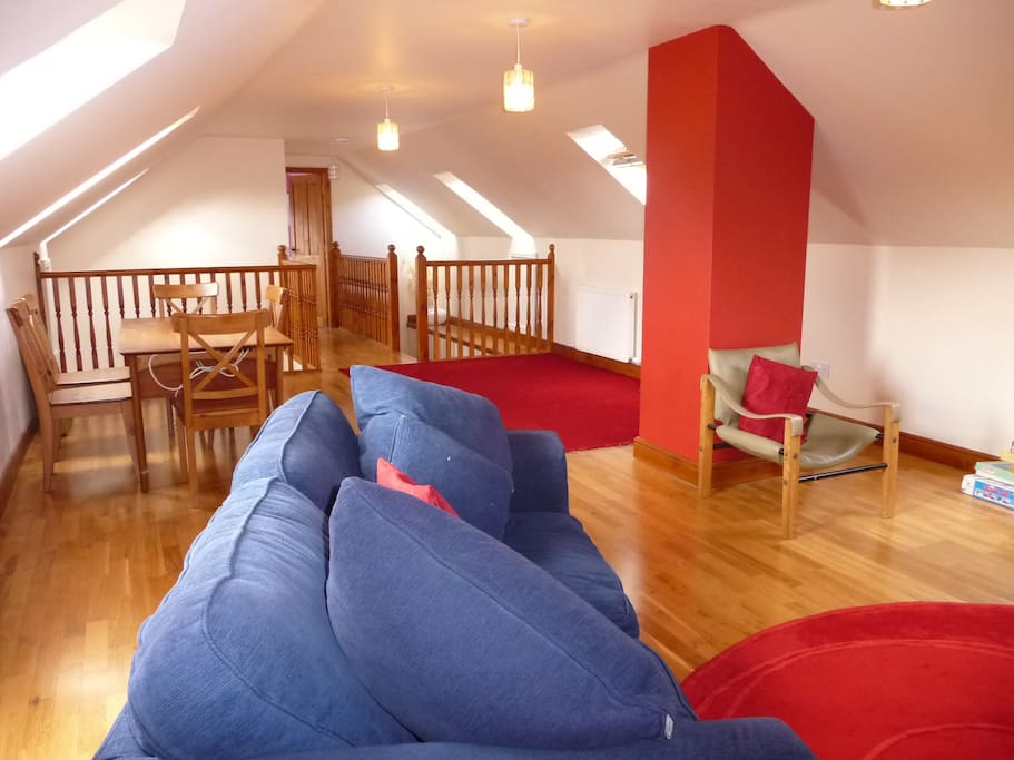 Upstairs studio area with sofa bed for added capacity