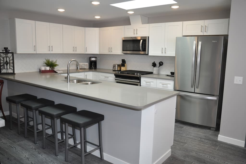 Stone Counter-tops, full sized kitchen. stocked with Dishes, Pans, Blenders, and Coffee Maker