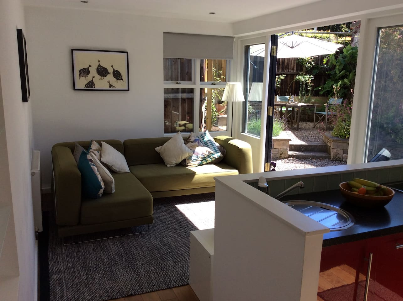 Fully furnished open plan garden flat with day room leading on to secluded private garden.