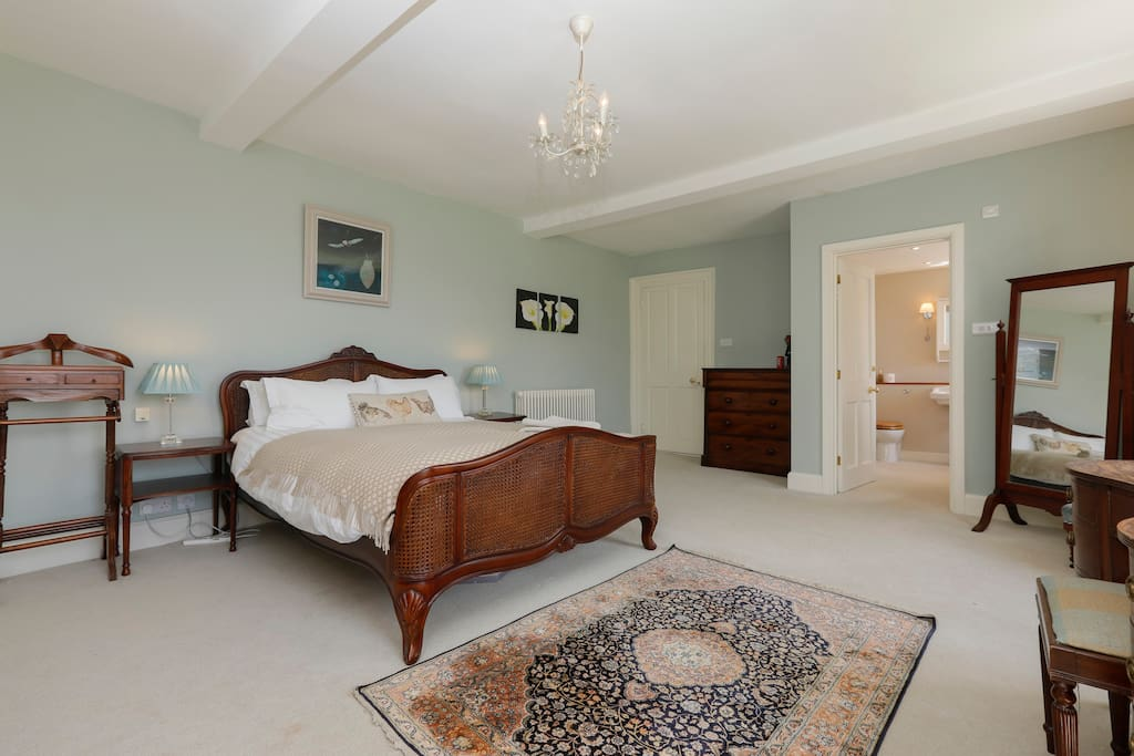 The master bedroom is a cosy haven, with a large, comfy king size bed, dressing table, trouser press and en suite bathroom. Sweeping views of the gardens and valley beyond can be observed from these rooms.