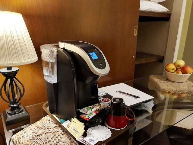 A Keirig coffee and tea brewer is on all desks in all rooms for convenience of resh coffee at any time. Snack are put out with this machine in case you do not want a hot breakfast because of time contraints.