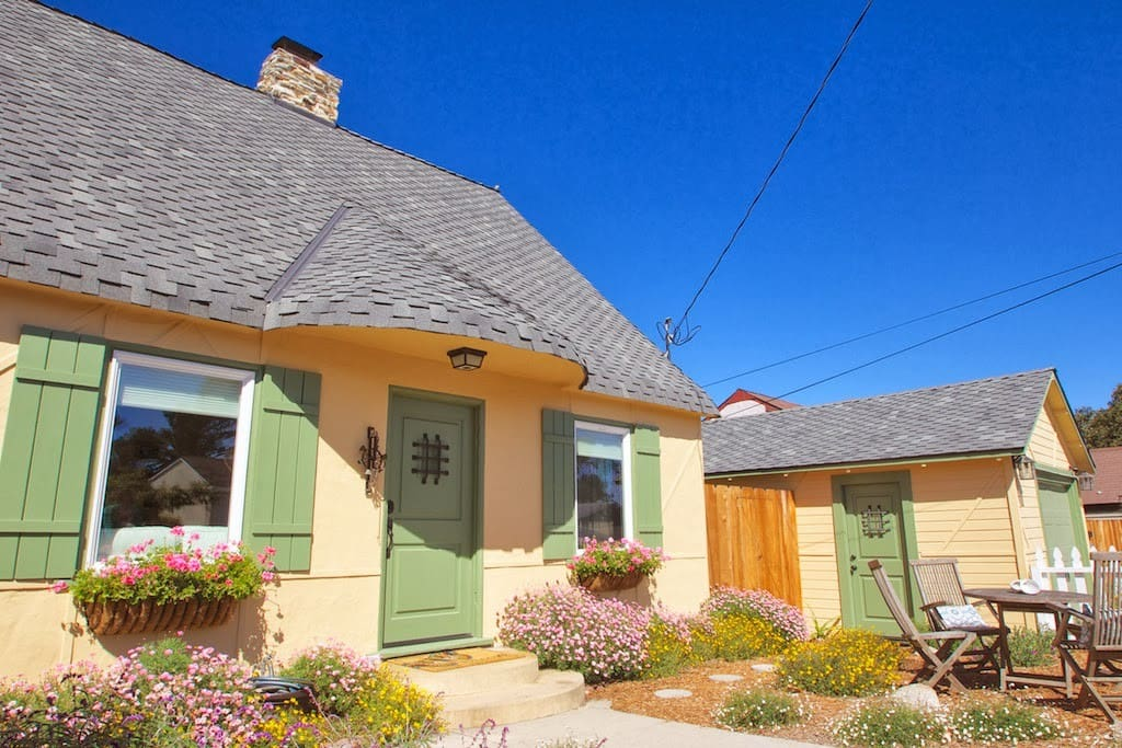 Come in through the white picket fence to this Storybook Cottage.