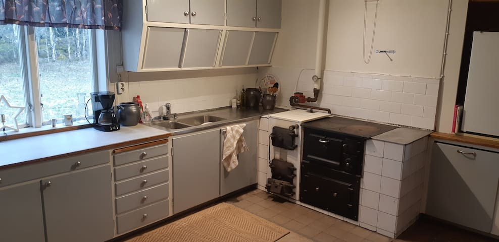 Kitchen with old stove (white for heating and black as decoration)