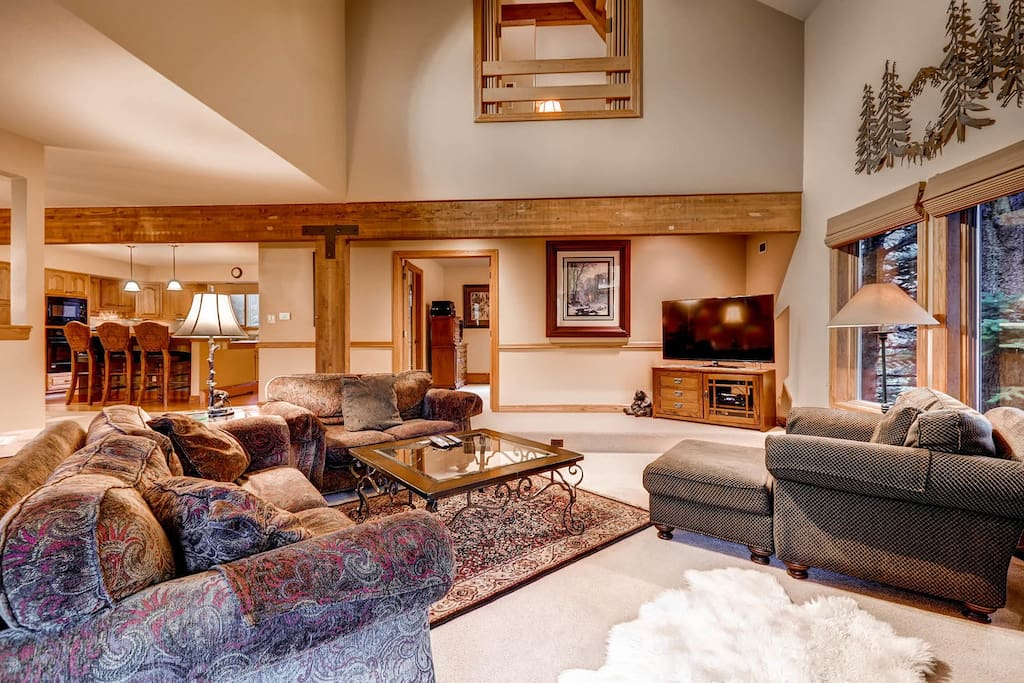 A lodge-style living room seats 6 on luxury sofas and an arm chair.