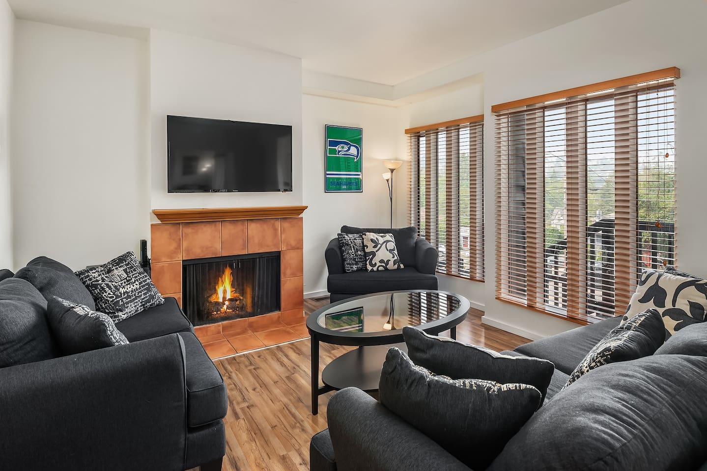 The cozy, light-filled living room has plenty of room and overlooks Madison Street.
