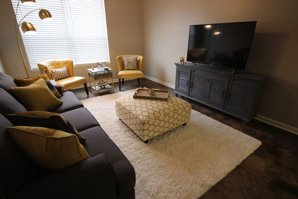 """Huge 55"""" LCD complete with Roku device which comes complete with Cable, Netflix, Hulu, and more for your entertainment needs! Queen size couch bed that unfolds from the couch."""