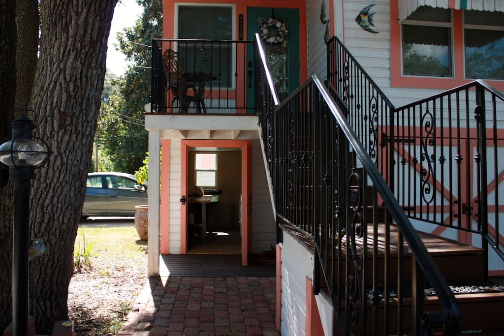 Iron handrails lead to the quaint porch and entrance