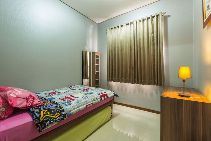 The 4th room on 1st floor 2 single beds,  one bed is below the other and can be moved  out. This room is equipped with AC.