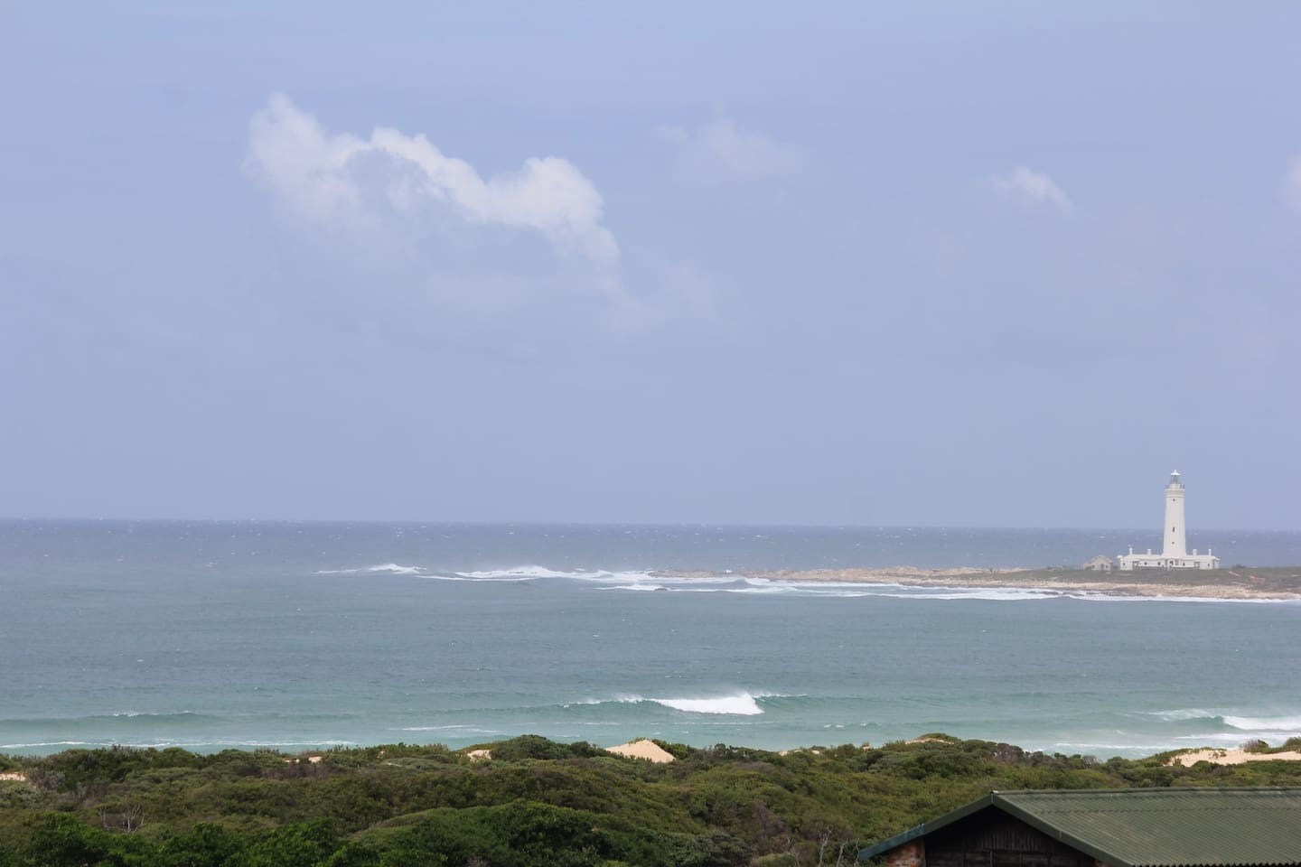 Balcony view 1: a picture worth a thousand words: Our beautiful lighthouse and Seal point surf break