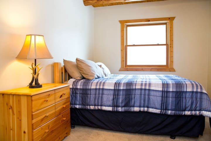 This first floor bedroom is furnished with a pillow top mattress and gives privacy to its occupants. A nearby full bath is very convenient.