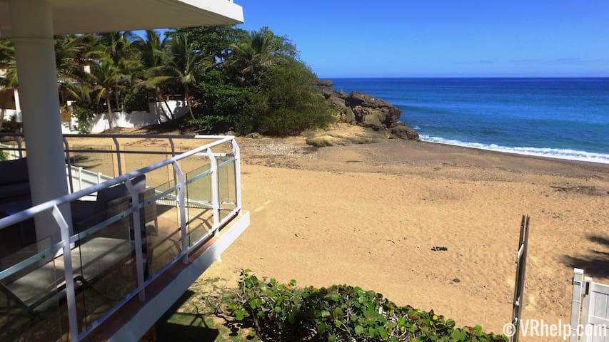 Our balcony hangs over famous Sandy Beach, the very best location in Rincón.