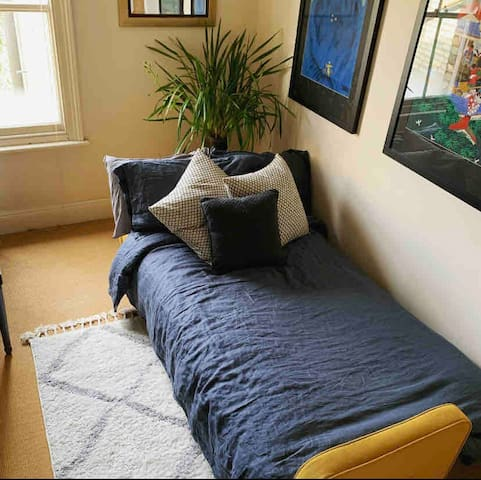 Upstairs home office converted into guest bedroom.
