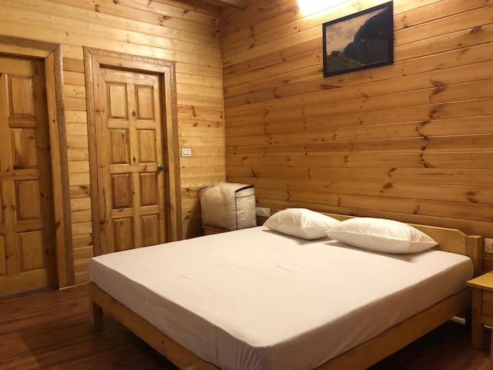 Wooden room having beautiful greeny view