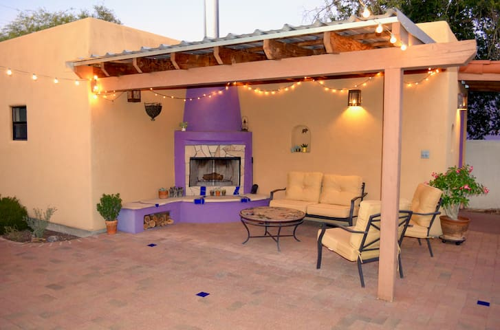 The yard is yours to explore and enjoy! The outdoor beehive fireplace with covered dining area is perfect for al fresco dinners.