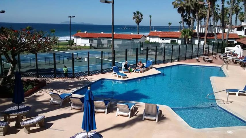 Swimming pool area and Tennis Court