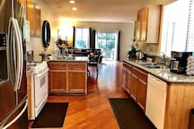 Kitchen; refrigerator/freezer, dishwasher, microwave, pots and pans, silverware, plates, glasses, toaster, electric kettle, coffee and coffee  maker and many more
