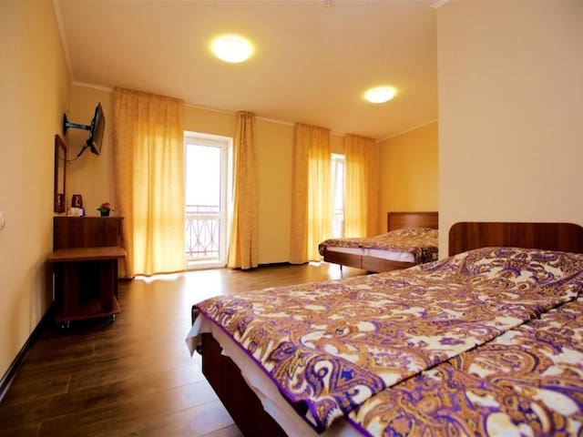4-bed room with balcony. WELL HOTEL