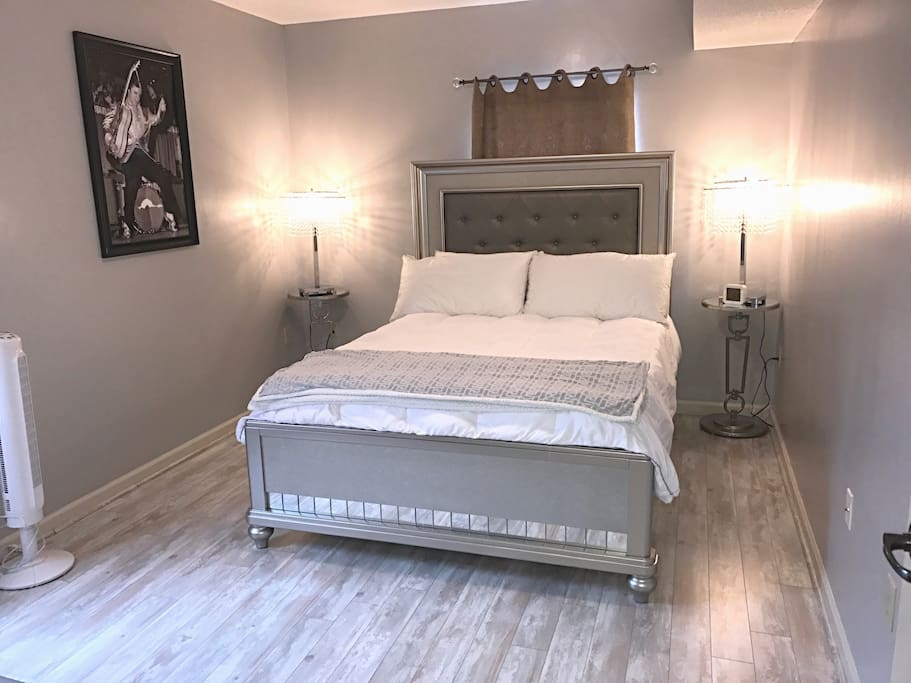 The bedroom boasts a Queen bed with memory foam mattress.