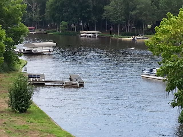 Another view of Lake Oconee from back porch overlooking your own private dock. Your choice...you can swim, fish or eat on the dock and listen to music and have your favorite beverage while you enjoy life at the Love Shack!  Or tie up boat or jet ski!