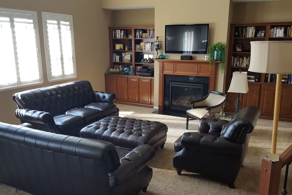 The family room has enough seating for all to enjoy watching TV or just talking about the day.