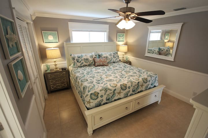 """Master bedroom has just been entirely redone.  King bed with a brand new very thick pillowtop mattress.  New dresser, nightstands, lamps and more.  All new sheets, comforter, pillows, etc.  40"""" TV with Netflix, tile flooring and a large closet too."""