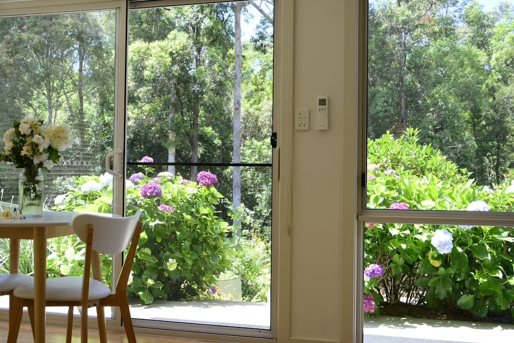 View from the lounge and dining area with private and tranquil garden setting.