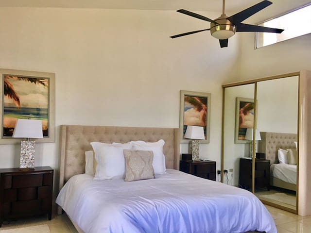 """Master Bedroom en-suite: King Bed; 50"""" Television; Bedside tables with crystal lamps; upholstered headboard and plush linens plus plenty of closet space.  Water views from this room!!"""