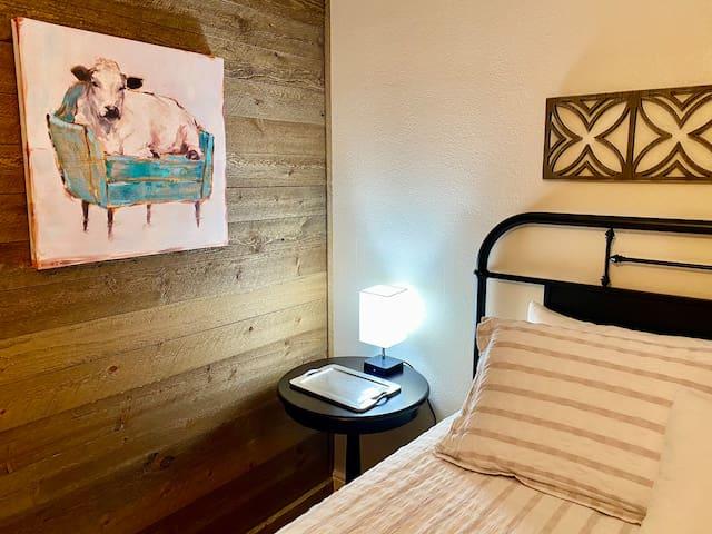 1 queen size bed in bedroom off kitchen.