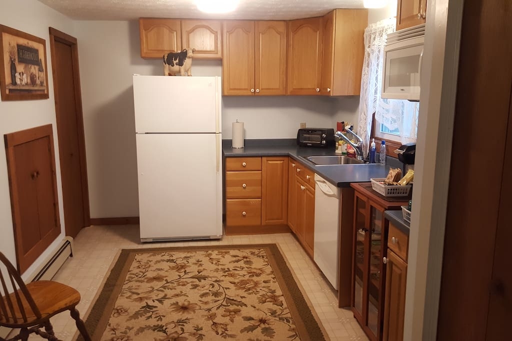 Kitchen includes toaster oven, microwave, hot plate, and griddle  for cooking, coffee pot, and a full fridge. Everything you need to cook and serve. Excludes full sized oven, per town ordinance.