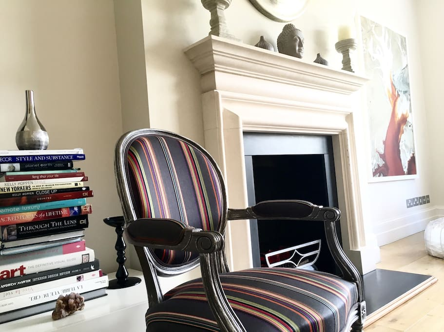 This is a cosy sitting room with inspiring books, interesting art and comfortable furniture.