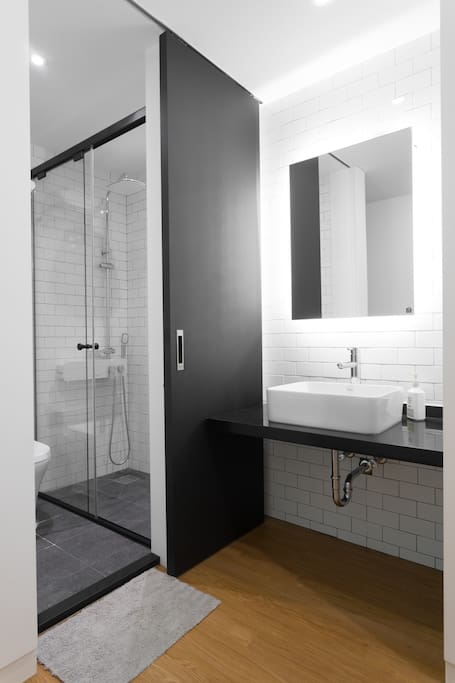 The western-style bathroom has a separate washbasin with backlit mirror