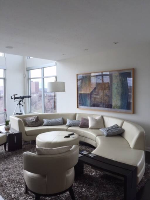 The living room is comfortable as well as elegant and features an Eames chair looking out at the river.