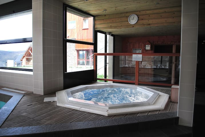 Warm up in the shared hot tub.