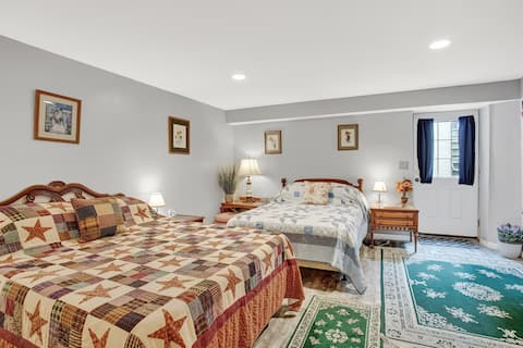 We are keeping everything safely sanitized and welcoming guests in our home during the corona situation.  Bedroom with two beds and bathroom plus sitting area with huge TV, coffee, fridge, microwave - total basement renovation!  Sleeps up to 4.