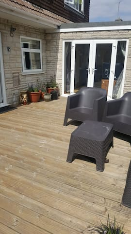 Guests have use of the decking area, it's a sun trap!