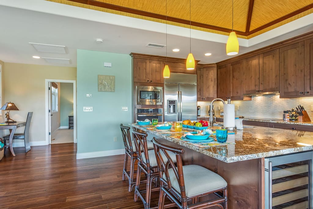 Gleaming granite and stainless steel modern gourmet kitchen.