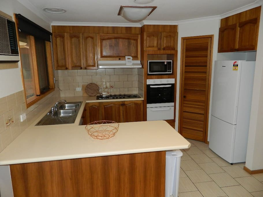 Fully equipped kitchen with oven, gas stove, Microwave, dishwasher & Family size fridge