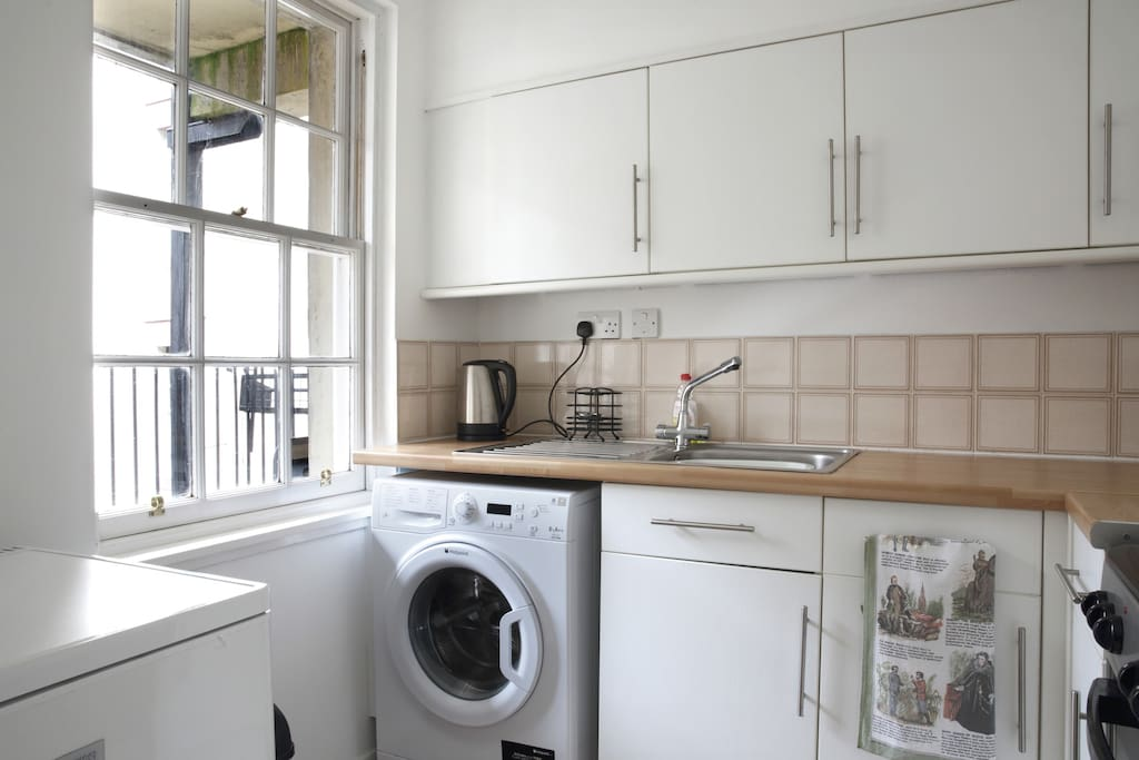 kitchen includes plenty cupboard space and includes tea, coffee, biscuits etc. Also includes a new washing machine