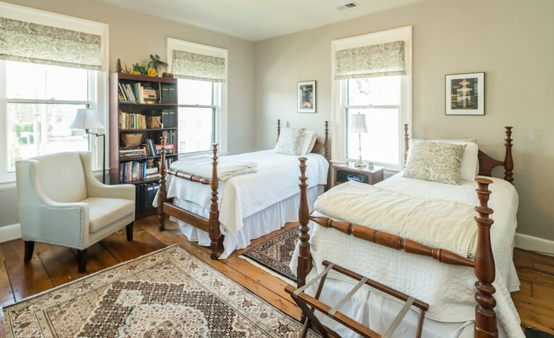 Schuyler's Room -- Two extra long twin beds in a big sunny room facing the street with a chair for reading and relaxing