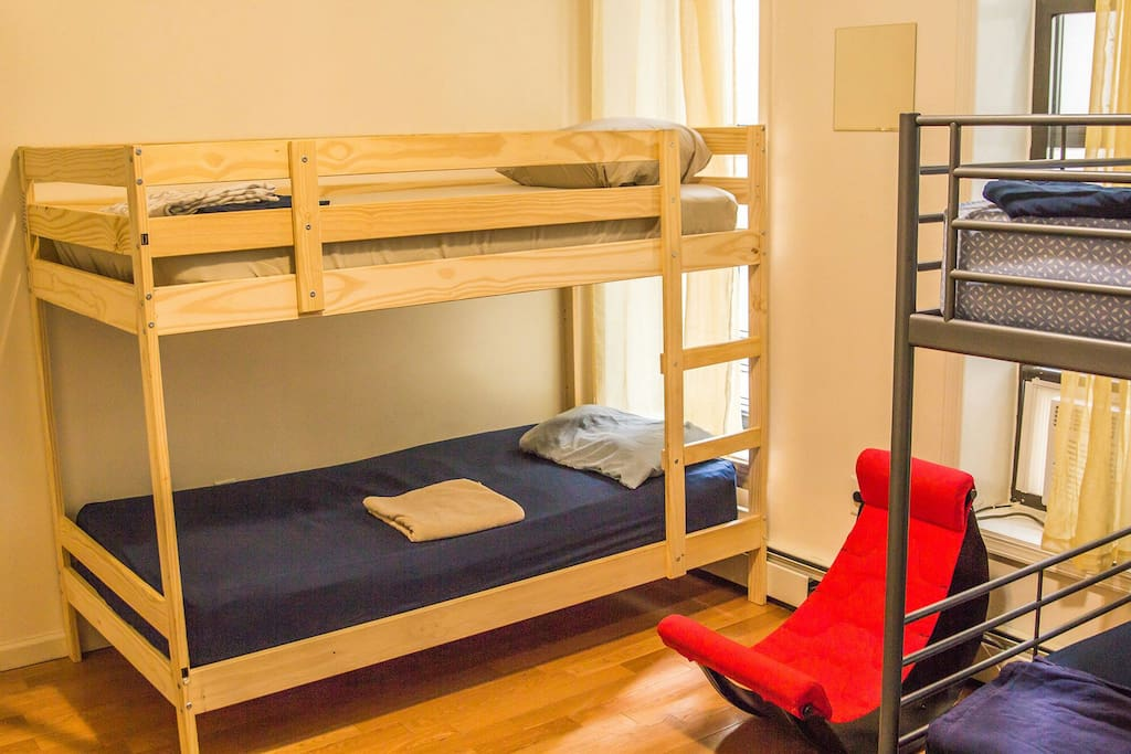 Clean and Cozy Bedroom with 3 Bunk Beds