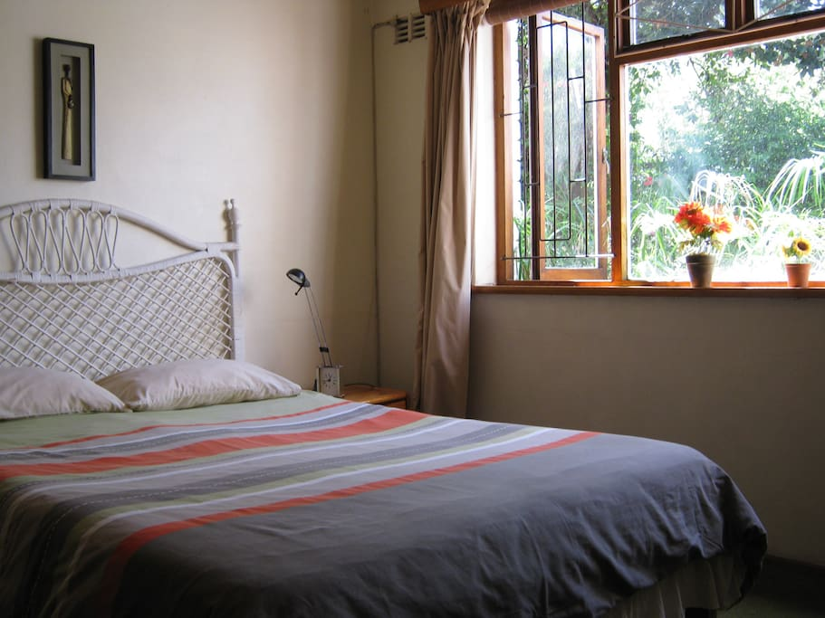 Spacious, sunny fully furnished, double room overlooking garden